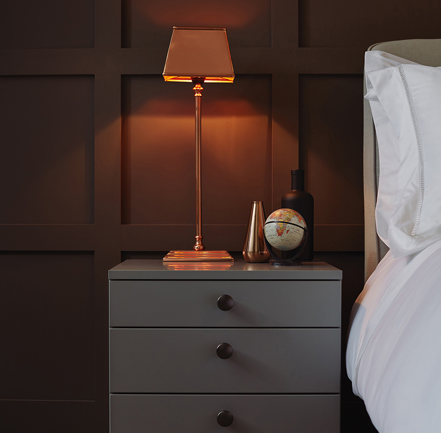 Complete the room with a copper bedside lamp