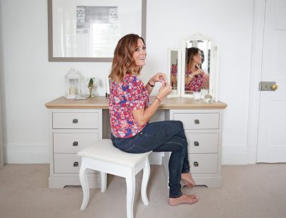 Natalie Pinkham sitting at dressing table