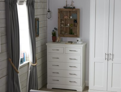 A image from the Origin Style 2 range featuring a wardrobe chest within a coastal theme.