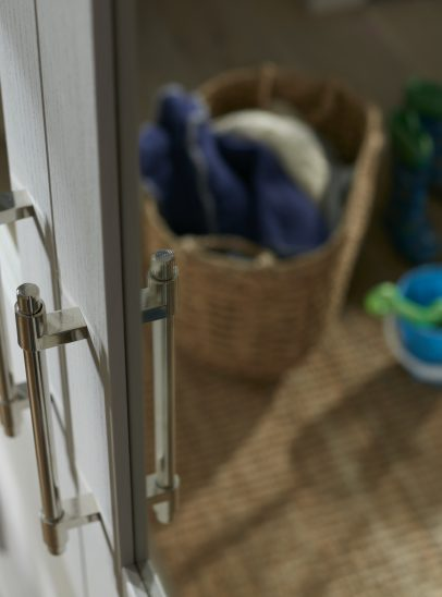 A photograph of a wardrobe from the kindred origin range with a reflection of a bucket and spade in the window.